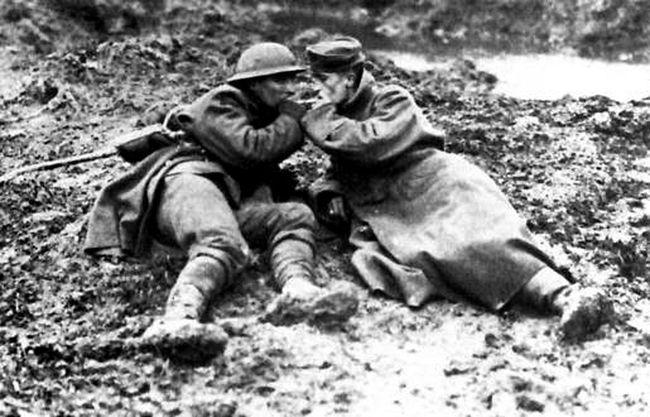 Two Canadian Soldiers Share Cigarettes on the Battlefield. [Image Source: stcatharinesstandard.ca]