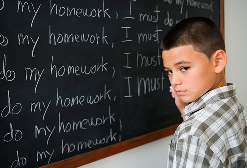 getty_rf_photo_of_boy_writing_on_blockboard